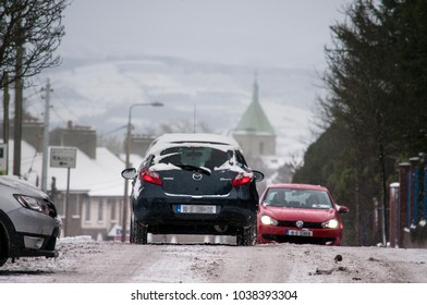 DUBLIN.IRELAND - February 28 , 2018:The traffic on  street which is covered with snow as a result of a snow storm in Ireland.