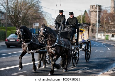 DUBLIN.IRELAND - January 05 , 2018: Horse drawn Hearse harnessed by black horses leaves Glasnevin Cemetery