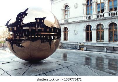 Dublin/Ireland - January 4,2019 : Arnaldo Pomodoro 'Sfera con Sfera' (Sphere Within Sphere) bronze sculpture at The Berkeley Library forecourt, Trinity College Dublin