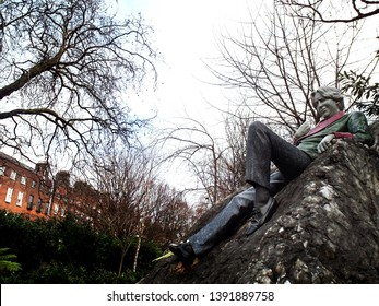 Dublin/Ireland - January 4,2019 : Oscar Wilde Memorial Sculpture (by English sculptor Danny Osborne) at Merrion Square in Dublin, Ireland, commemorating the famous Irish poet and playwright.