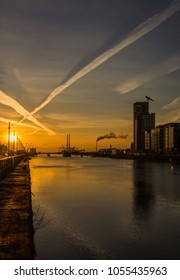 Dublin/Ireland - March 20 2018: Sunrise over Dublin Docklands and the river Liffey in March.