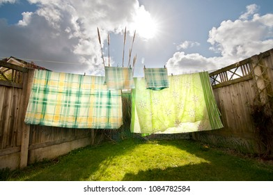 DUBLIN.IRELAND - March 25, 2018: Colorful bed linen is drying in the yard on a sunny spring day