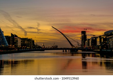 Dublin/Ireland - October 12 2017: Sunrise on the River Liffey, Dublin, Ireland with the Samuel Beckett Bridge in frame.