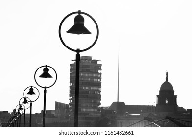 DUBLIN.IRELAND-June 03,2018: black and white silhouettes of the city of Dublin: lanterns on the embankment, Spire,buildings