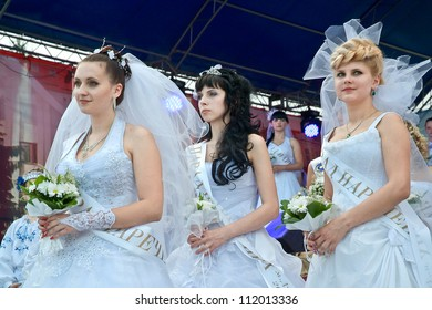DUBNO, UKRAINE -  AUGUST 25, 2012: Celebration of an Independence Day of Ukraine and City Day Dubno, Rovno area. Parade of brides 18-28 age. August 25, 2012