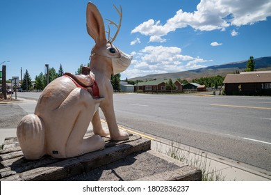 Dubois, Wyoming - June 24, 2020: The Worlds Largest Jackalope statue at the gas station along the roadside. Wearing a mask due to COVID-19 Pandemic