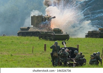 DUBOSEKOVO, RUSSIA - JULY 13: KV-2 battle tank is hit by German anti-tank cannon during Field of Battle military history festival on July 13, 2013 in Dubosekovo, Russia