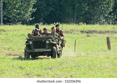 DUBOSEKOVO, RUSSIA - JULY 13: military history club members reenacting Allies recon patrol ride Willys MB jeep during Field of Battle military history festival on July 13, 2013 in Dubosekovo, Russia