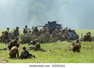 DUBOSEKOVO, RUSSIA - JULY 13: military history club members in Soviet WWII uniform defend position during Field of Battle military history festival on July 13, 2013 in Dubosekovo, Russia