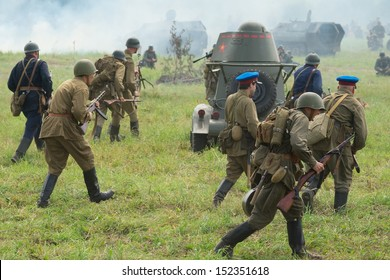 DUBOSEKOVO, RUSSIA - JULY 13: military history club members in Soviet WWII uniform reenact advancement during Field of Battle military history festival on July 13, 2013 in Dubosekovo, Russia