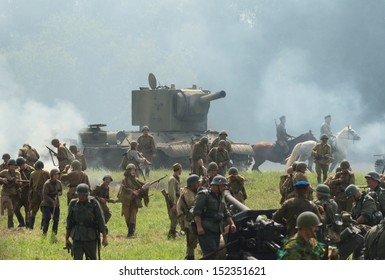 DUBOSEKOVO, RUSSIA - JULY 13: military history club members in Soviet WWII uniform overrun enemy positions during Field of Battle military history festival on July 13, 2013 in Dubosekovo, Russia