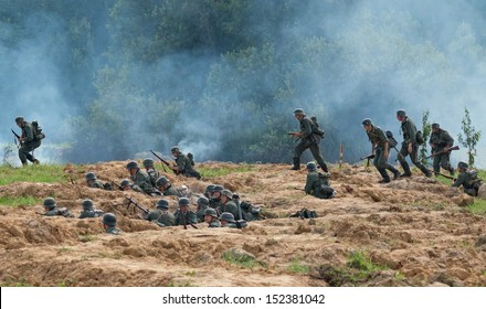 DUBOSEKOVO, RUSSIA - JULY 13: military history club members in WWII German uniform overrun the trenches  during Field of Battle military history festival on July 13, 2013 in Dubosekovo, Russia