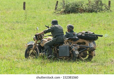 DUBOSEKOVO, RUSSIA - JULY 13: military history club members in German WWII uniform ride a BMW R75 bike during Field of Battle military history festival on July 13, 2013 in Dubosekovo, Russia
