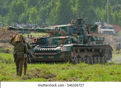 DUBOSEKOVO, RUSSIA - JULY 13: PzKpfw IV battle tank stands during Field of Battle military history festival on July 13, 2013 in Dubosekovo, Russia
