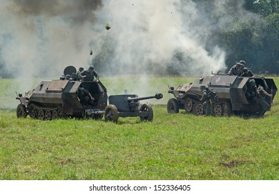 DUBOSEKOVO, RUSSIA - JULY 13: two Wehrmacht SdKfz.251 APCs run under the barrage during Field of Battle military history festival on July 13, 2013 in Dubosekovo, Russia