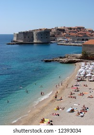 "Dubrovnik beach ""Banje"" is well known pebble beach with a beautiful views over Dubrovnik Old Town. It is located in front of the eastern entrance (Ploce Gate) to Dubrovnik Old Town bellow."