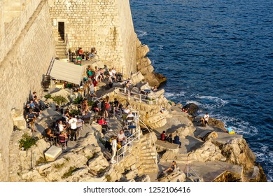 Dubrovnik, Croatia - 10.23.2018. - Peple sitting on the old town coast and chilling