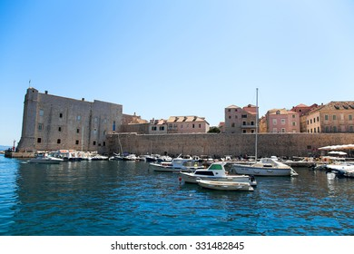 DUBROVNIK, CROATIA - 24 AUGUST 2015 - tourist boats in The Old Town Harbor of Dubrovnik offers a wide variety of trips and excursions in the Adriatic Sea.