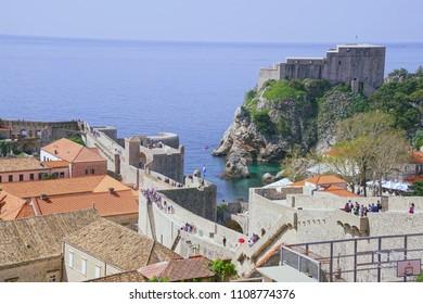 DUBROVNIK, CROATIA - APR 14, 2018 - Tourists walking along the outer walls of Dubrovnik, Croatia