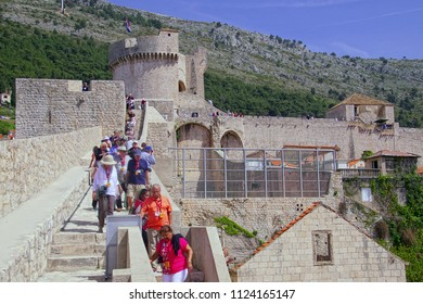 DUBROVNIK, CROATIA - APR 14, 2018 - Tourists walking along the outer walls of Dubrovnik, Croatia
