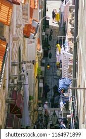 DUBROVNIK, CROATIA - APR 14, 2018 - Narrow street in the old city of Dubrovnik, Croatia