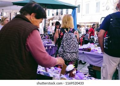 DUBROVNIK, CROATIA - APR 14, 2018 - Selling fresh lavender in the old city market of Dubrovnik, Croatia