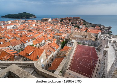 Dubrovnik, Croatia - April 2018 : Basketball pitch in front of the old houses and buildings in Dubrovnik, viewed from the Old Town fortified walls