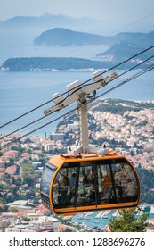 Dubrovnik, Croatia - April 2018 : Dubrovnik cable car, a popular tourist attraction taking people on the top of a Mount Srd above the historical Old Town Walls