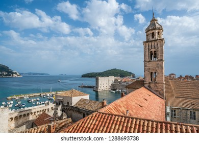 Dubrovnik, Croatia - April 2018 : Church bell tower and rooftops of old houses in Dubrovnik, viewed from the Old Town fortified walls
