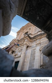 Dubrovnik, Croatia - April 2018 : Girl taking slefie in front of the entrance of an old historical building in the Dubrovnik Old Town