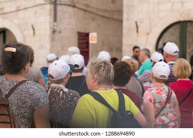 Dubrovnik, Croatia - April 2018 : Organized tour of tourists walking on the main street in Dubrovnik Old Town