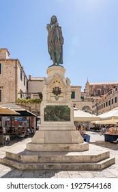 Dubrovnik, Croatia - Aug 20, 2020: Bronze Statue of Civu Frana Cundulica Narod in old town in summer