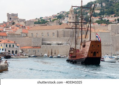 DUBROVNIK, CROATIA - AUGUST 13, 2015: HBO television show Game of Thrones tourist sailing ship entering a harbour of the old town of Dubrovnik, Croatia.
