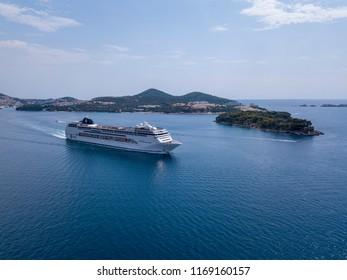 DUBROVNIK, CROATIA - August 2018: Beautiful white cruise liner goes into the sea. Cruise on the Adriatic Sea. Croatia.