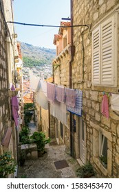 Dubrovnik, Croatia - august 2018; Clean towels drying on a laundry line, in a street of Dubrovnik's old town