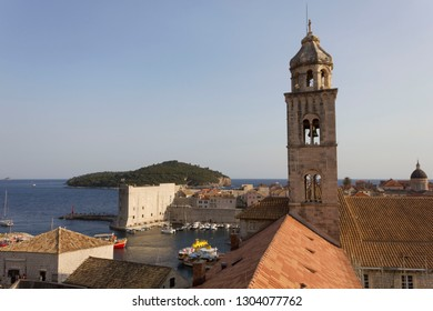 DUBROVNIK, CROATIA - AUGUST 22 2017: View from the top of Dubrovnik with bell tower and Lokrum island in the background