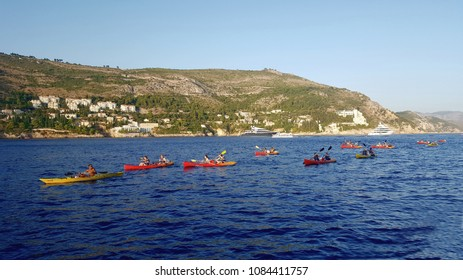 Dubrovnik, Croatia, August 24, 2016: Group of happy people on a kayaks