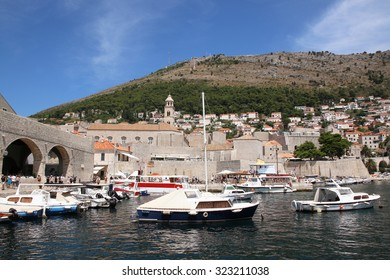 DUBROVNIK, CROATIA - AUGUST 4, 2015: Harbor of the Old town of Dubrovnik, Croatia. Dubrovnik is a UNESCO World Heritage site