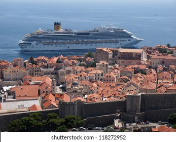 DUBROVNIK, CROATIA - JULY 16: The Costa Favolosa cruise ship passes very close to the old town walls, in Dubrovnik, Croatia on July 16, 2011