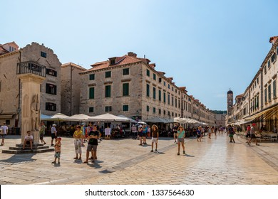 DUBROVNIK, CROATIA - JULY 18, 2015: Perspective city view of buildings and people in the old town at the town square and along the main street in Dubrovnik Croatia July 18, 2015.