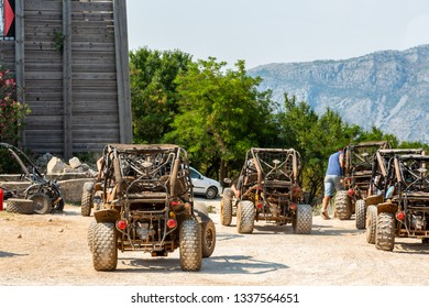 DUBROVNIK, CROATIA - JULY 18, 2015: Daytime landscape back view of several dune buggy vehicles and incidental people in the background in Dubrovnik Croatia July 18, 2015.