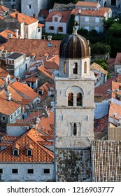 Dubrovnik, Croatia, July 29, 2018: Bell tower of the Franciscan Monastery in Dubrovnik, Croatia, originated in the 13th century, destroyed in the 1667 earthquake, rebuilt in the 17th century.