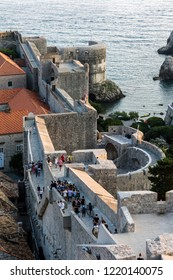 Dubrovnik, Croatia, July 29, 2018: Dubrovnik city walls, the finest in the world and the city's main claim to fame. Entire old town was contained within a stone barrier 2km long and up to 25m high.