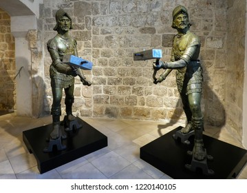 Dubrovnik, Croatia, July 29, 2018: One of the Dubrovnik's Clock Tower bell striking bronze figures, supposedly depicting ancient Roman soldiers, sculpted by the local masters in the 15th century.