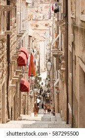 DUBROVNIK, CROATIA - July 3: Tourists walking up the narrow street with shops and restarants on July 3, 2009 in Old Town of Dubrovnik, Croatia