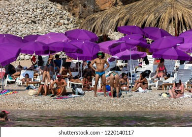 Dubrovnik, Croatia, July 31, 2018: Sveti Jakov Beach, one of the most beautiful beaches in Dubrovnik, located in the in the tiny bay offering a distant look to the Lokrum and the Dubrovnik Old Town.