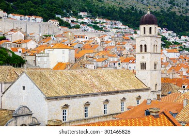 DUBROVNIK, CROATIA - JUNE 26, 2015: Scene of the walls, with the Franciscan Monastery, locals and tourists, in Dubrovnik, Croatia