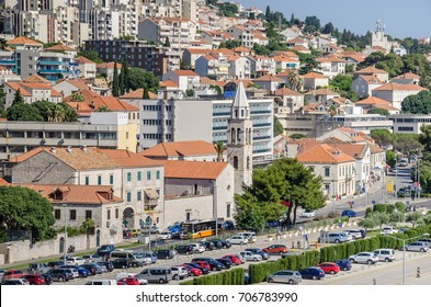 Dubrovnik, Croatia - June 9, 2017:  Modern part of Dubrovnik, rebuild after the war and the break-up of Yugoslavia, part of the street Obala Stjepana Radica with a church and apartments hotels