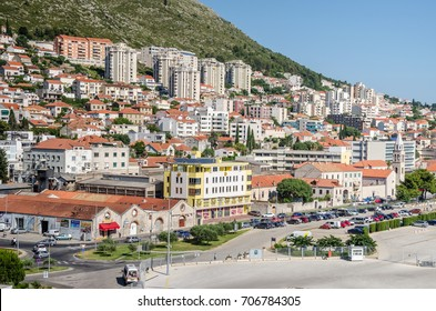 Dubrovnik, Croatia - June 9, 2017:  Modern part of Dubrovnik, rebuild and renewed after the war and the break-up of Yugoslavia, the street Obala Stjepana Radica with a church and apartment hotels