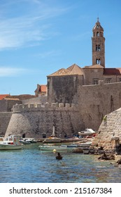 DUBROVNIK, CROATIA - MAY 28, 2014: View from city port on old city walls and Dominican church tower. City walls are on the UNESCO list of World Heritage Sites.